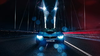 frederic-schlosser-sony-alpha-7R-face-on-blue-car-crossing-bridge-in-the-wet