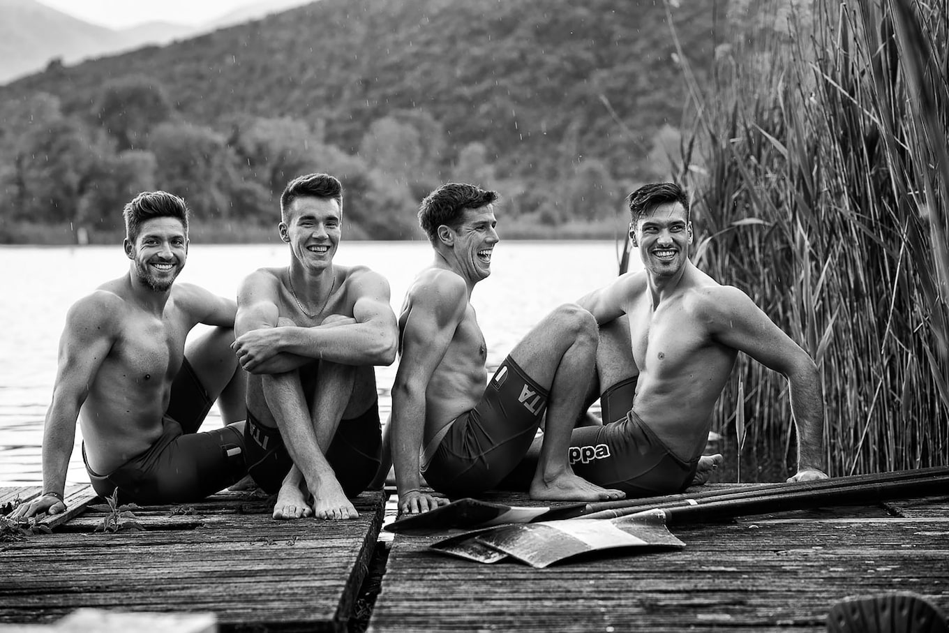maki-galimberti-sony-alpha-7RII-male-swimming-team-pose-on-jetty-by-lake